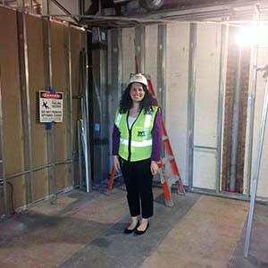 Lab manager Catherine DeRose standing in her future office