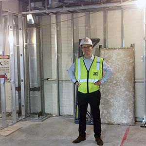 Lab developer Douglas Duhaime standing in his future office