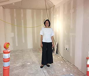 UX Designer Monica Ong Reed standing in her future office